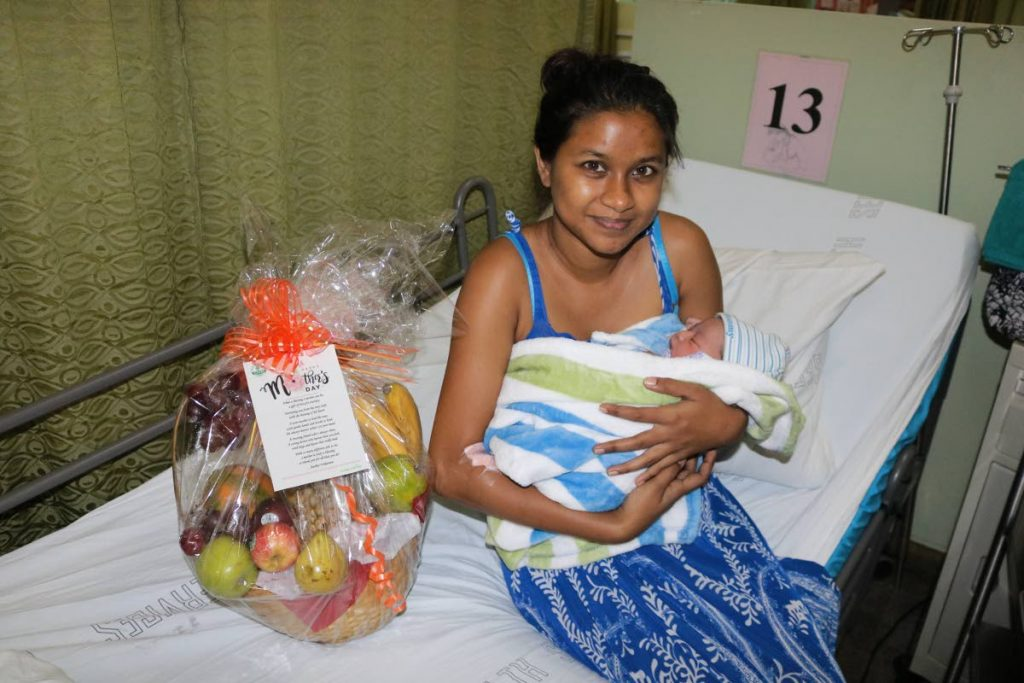 Mohini Rampersad is all smiles with her newborn baby at the Sangre Grande hospital on Sunday. - Eastern Regional Health Authority