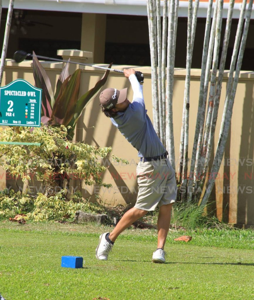 A golfer takes the first strike on the ball at the St Andrew's Golf Course, Moka Maraval. - ROGER JACOB