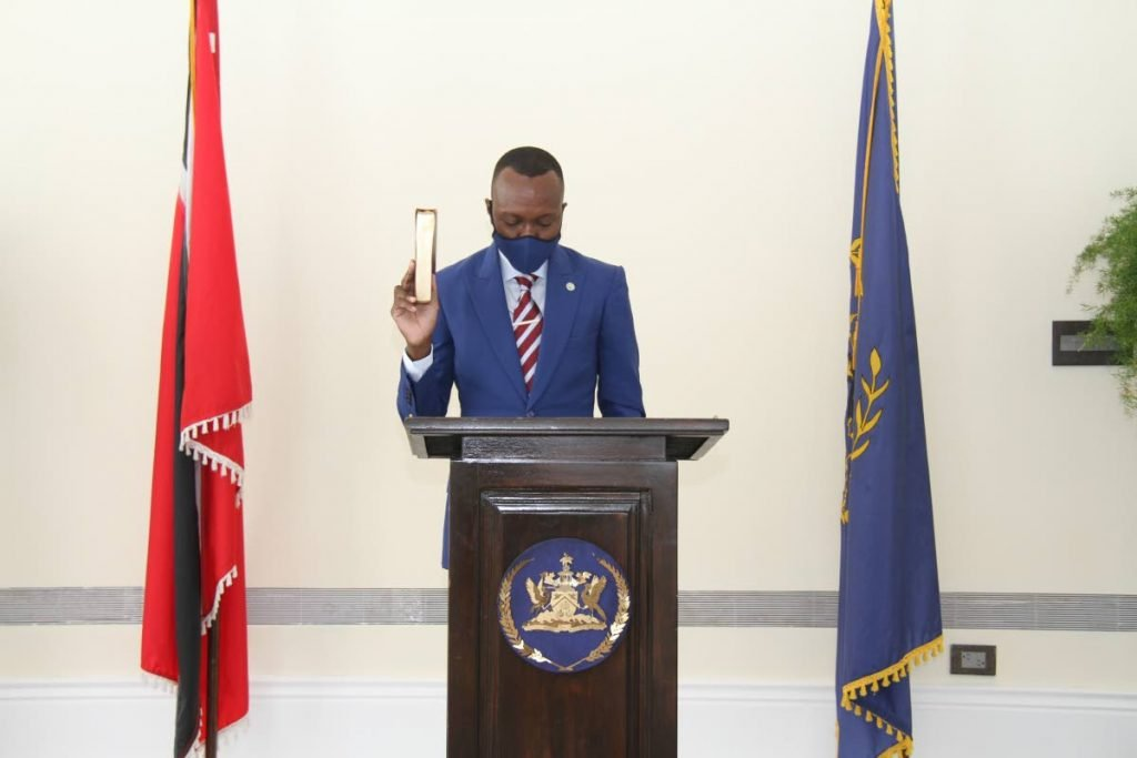 New Chief Secretary Ancil Dennis is sworn in by President Paula-Mae Weekes at President's House, St Ann's on Tuesday. PHOTO COURTESY OFFICE OF THE PRESIDENT  -