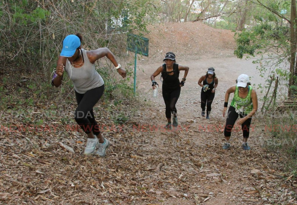 This group of women take a run up a track, off the Lady Chancellor Hill, St Ann's, on Tuesday, as part of their exercise routine. PHOTO BY AYANNA KINSALE. - Ayanna Kinsale