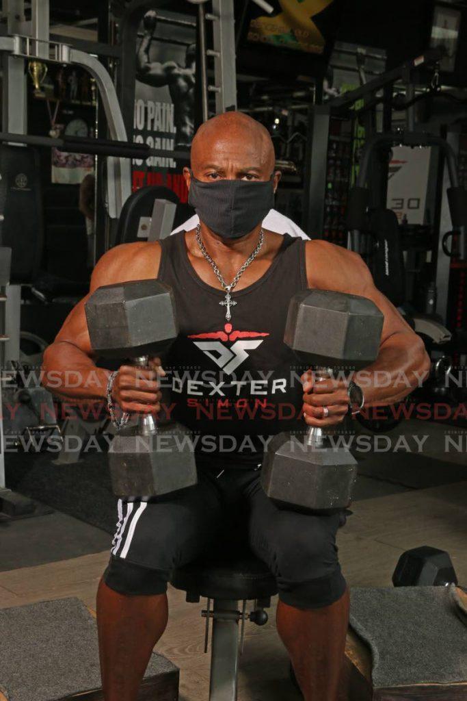 National bodybuilder Dexter Simon during a recent workout demonstration at the Asylum Training Centre, Diego Martin. - Marvin Hamilton