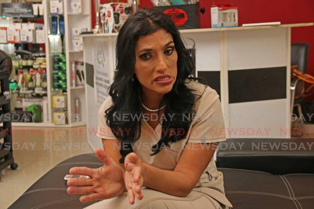 Hairdresser and animal rights activist Jowelle De Souza at her San Fernando salon last week. - Marvin Hamilton