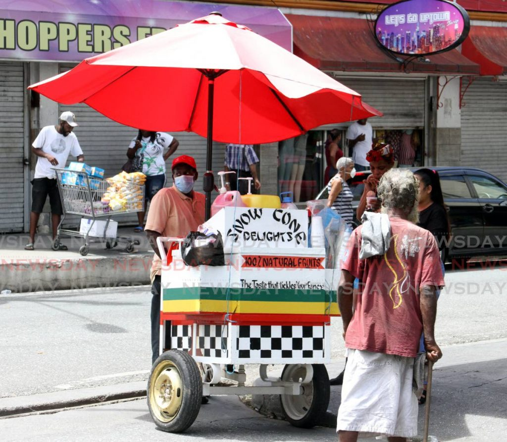 A sno-cone vendor was out looking for sales on Charlotte Street, Port of Spain on Saturday. - Angelo Marcelle