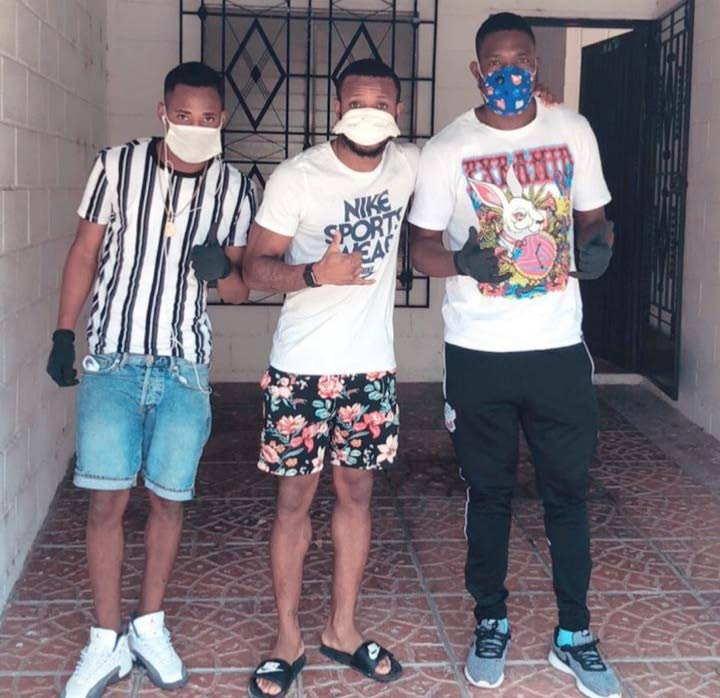 TT footballers Jomoul Francois (left), Jomal Williams (centre) and Jamal Jack pose after arrangements were made for them to be housed together and provided with relief. -