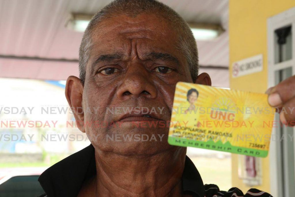 MANNING SUPPORTER: Roopnarine Ramdass displays his UNC membership card. He said on Monday that he would be voting for Brian Manning in the general election.   - Marvin Hamilton