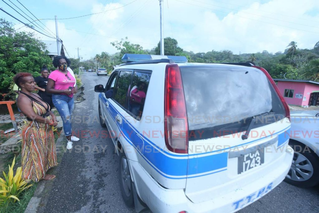 Police at the scene of a protest at La Lune, Moruga, on Thursday. - Lincoln Holder
