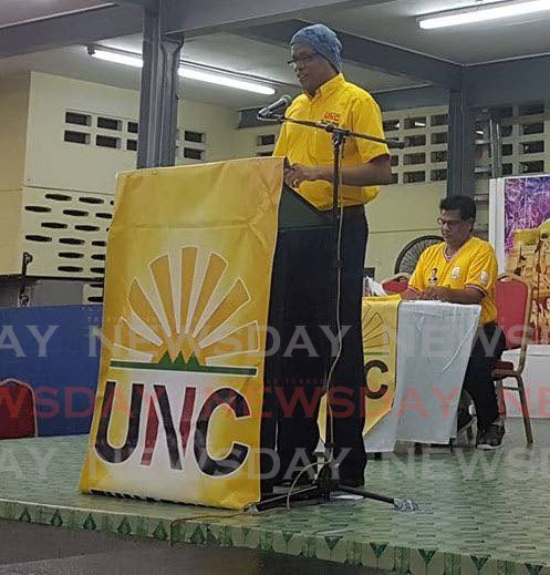 Dr Anderson Morris, UNC activist, speaks at the podium while San Juan MP Dr Fuad Khan listens in the background. Morris was found dead in a house in San Juan last week Thursday.   Photo taken from Dr Fuad Khan's Facebook page.  -