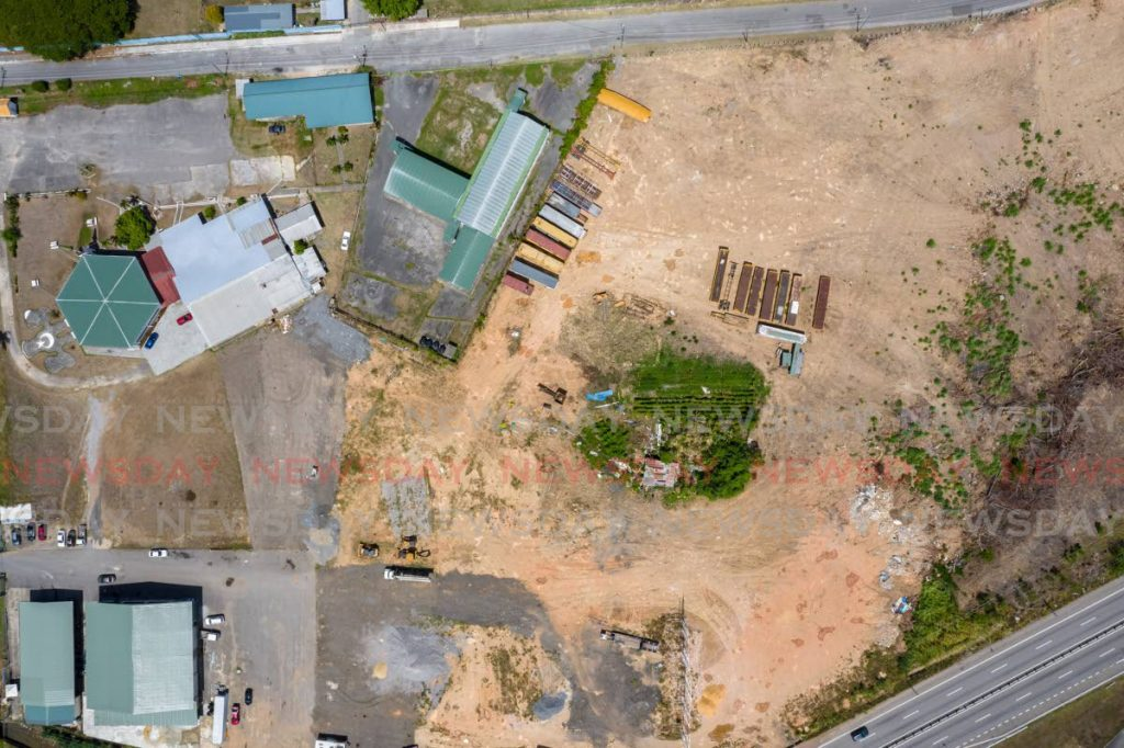 An aerial photo over the area of land near the Jamaat-al-Muslimeen's compound (top left) taken on Friday. -