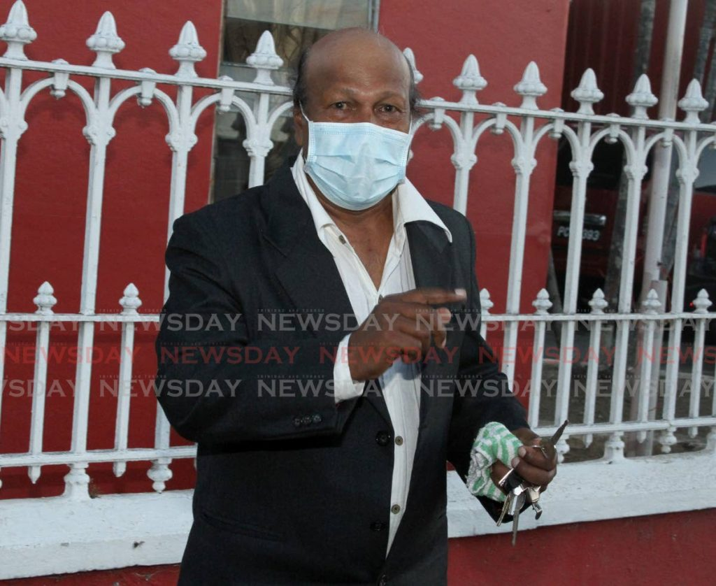 Romando G Rampersad leaves the Balisier House, Tranquility Street, Port of Spain, after PNM screening on Thursday. - Ayanna Kinsale