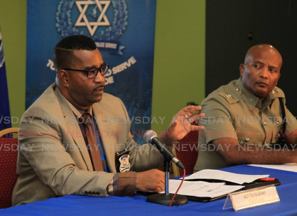 ASP. Curtis Julien speaks during a media briefing from the TT Poice Service while Assistant Superintendent of Police Wayne Mystar looks on. - ROGER JACOB