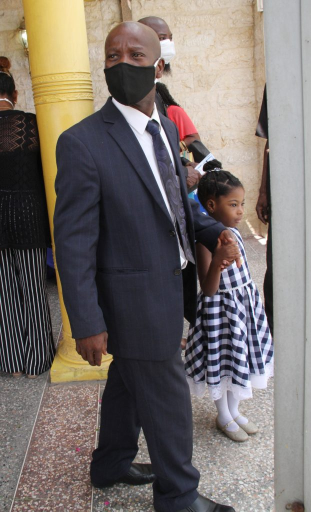 Ivan Thomas outside the funeral for his son, Iverson, at David Guides and Son Funeral Chapel in Couva on Friday. PHOTO BY VASHTI SINGH