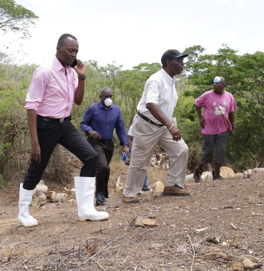 Chief Secretary Ancil Dennis, left, on a recent tour of the Courland Agricultural Development Project, Black Rock. PHOTO COURTESY THA  -