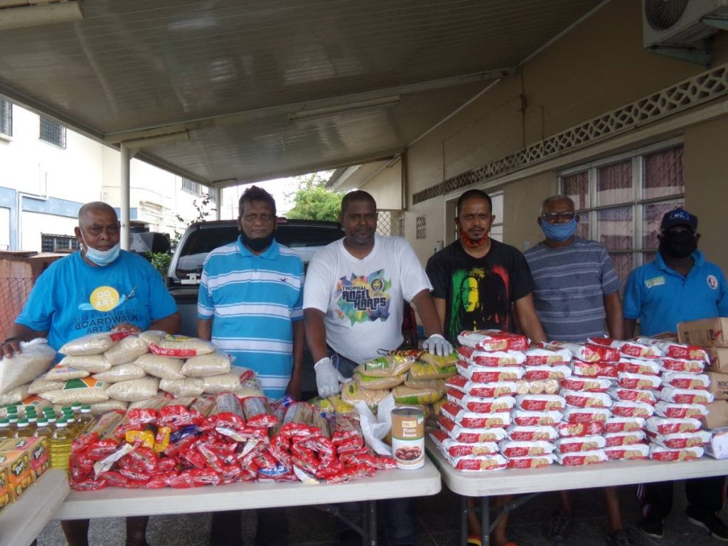 CENTRAL Zone umpires organise food relief hampers for the less fortunate. -