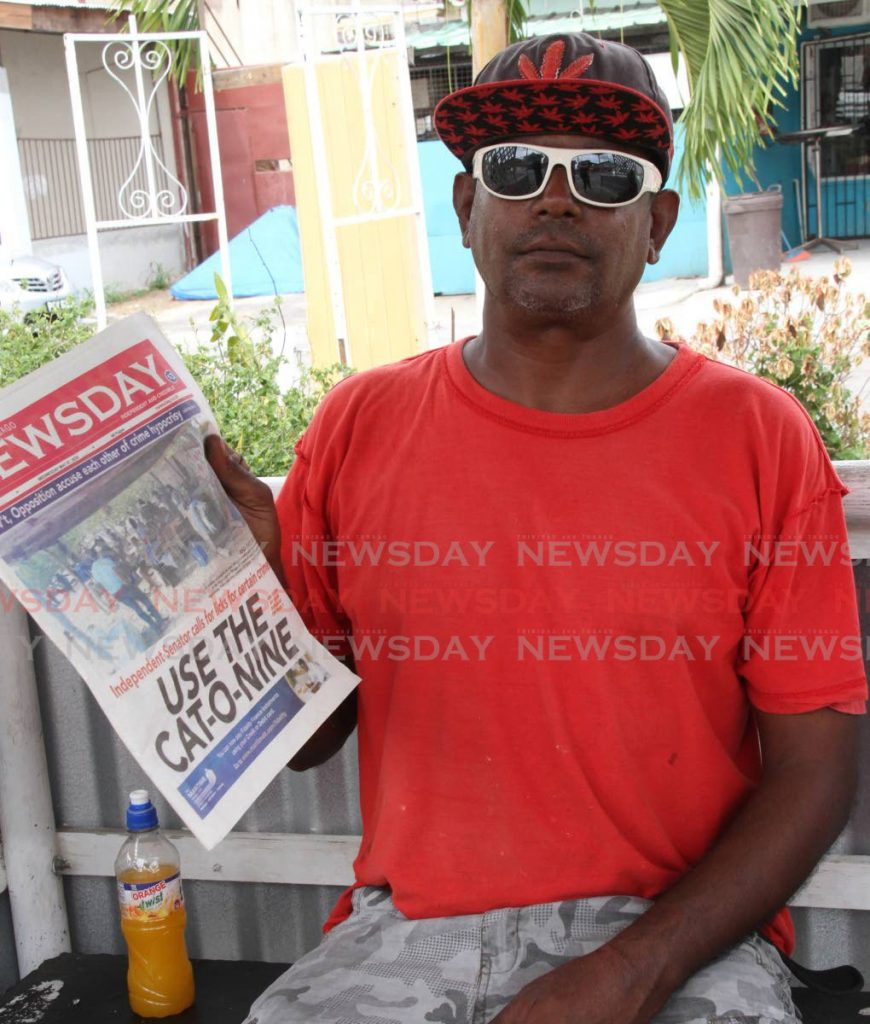 Tabaquite resident, Raoul, holds up Wednesday's Newsday which he was reading when he was approached for comment on the candidates being selected for the area in the upcoming general election.   - Vashti Singh