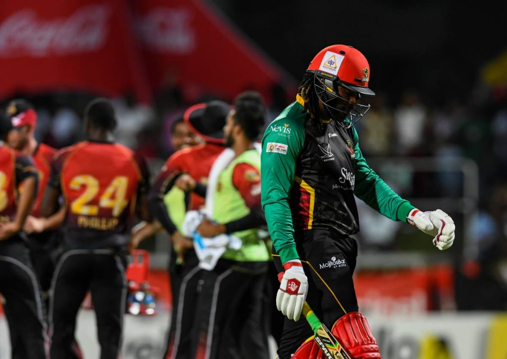 In this Sep 1, 2018 file photo, Chris Gayle (R) of St Kitts & Nevis Patriots walks off the field during match 23 of the Hero Caribbean Premier League between St Kitts & Nevis Patriots and Trinbago Knight Riders at the Warner Park Sporting Complex, in Basseterre, St Kitts. - (Photo courtesy Hero CPL T20)