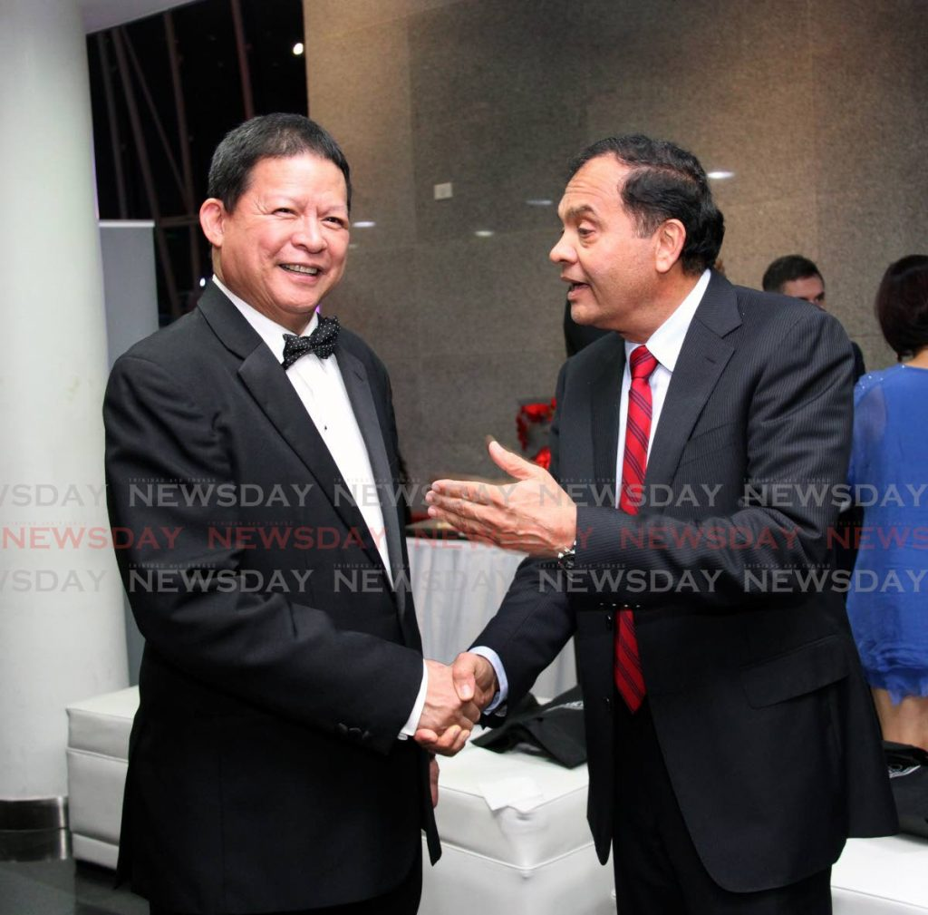 In this 2018 file photo, Coosal Group chairman Sieunarine Coosal (right) congratulates businessman Derek Chin who was inducted into the TT Chamber's Business Hall of Fame during the Champions of Business ceremony at the National Academy for the Performing Arts, Port of Spain. - SUREASH CHOLAI
