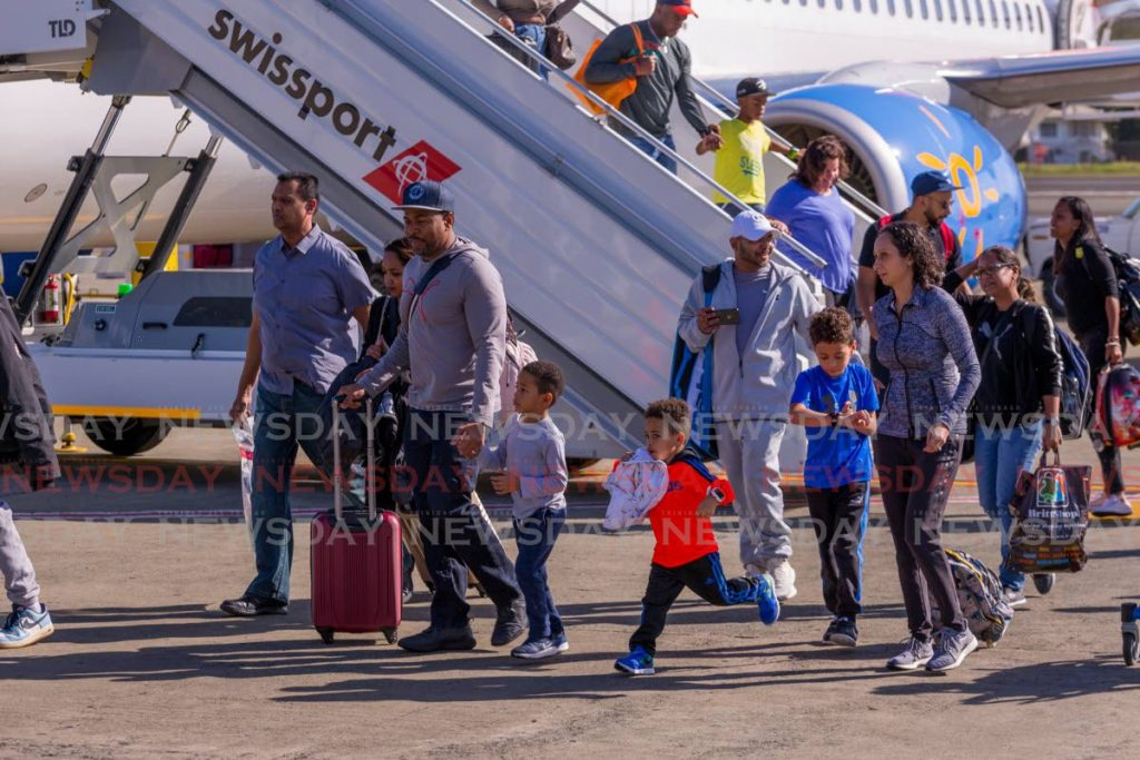 Passengers disembark Sunwing Airlines' inaugural Toronto to Tobago flight at the ANR Robinson International airport in December 2018. -