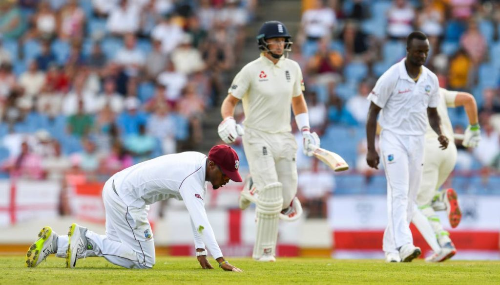 In this February 9, 2019 file photo, Kraigg Brathwaite (left) of West Indies fails to stop Joe Root (centre) of England from scoring off Kemar Roach (right) during the first day of the 3rd and final Test between West Indies and England at the Darren Sammy Cricket Ground, Gros Islet, St Lucia. (AFP PHOTO) -