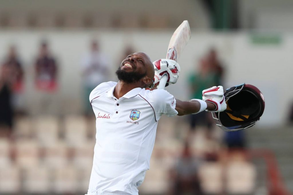 In this February 12, 2019 file photo, West Indies' Roston Chase celebrates after he scored a century against England during day four of the third Test match at the Daren Sammy Cricket Ground in Gros Islet, St Lucia.  (AP PHOTO) -