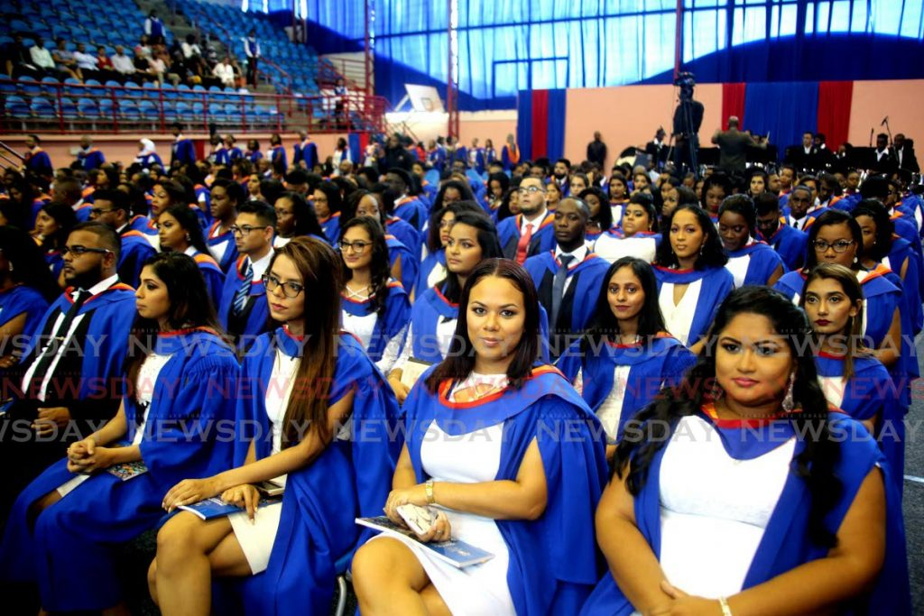 In this October 2019 file photo graduates from the UWI St Augustine Faculty of Social Sciences participate in a graduation ceremony at UWI Spec in St Augustine. Even before covid19 catapulted us into the future, automation and productivity tracking was already forcing universities to rethink their models.  - SUREASH CHOLAI
