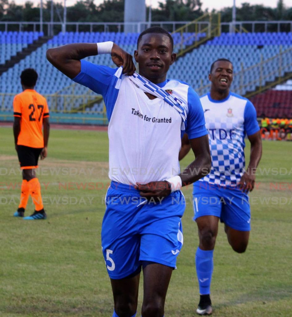 In this March 11 file photo, Dylon King of Defence Force, celebrates his first goal of the TT Pro League match against Tiger Tanks Club Sando, at the Hasely Crawford Stadium, Port of Spain. - ROGER JACOB