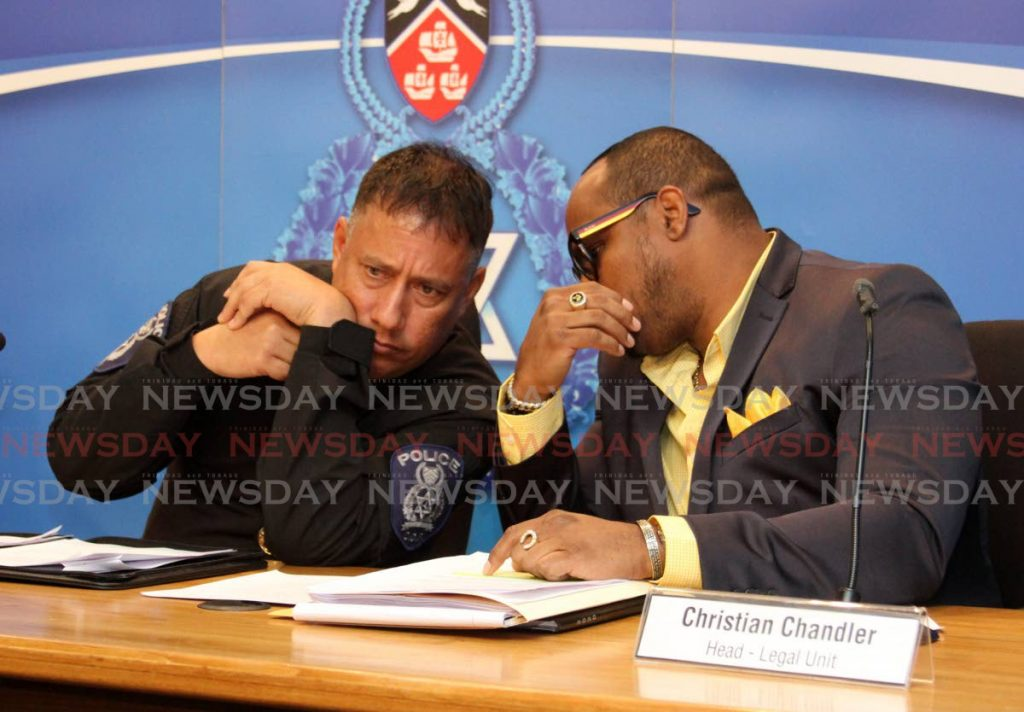 CoP Gary Griffith and the head of the police service legal unit Christian Chandler at a recent media briefing at Police Administration building in Port of Spain. - ANGELO MARCELLE