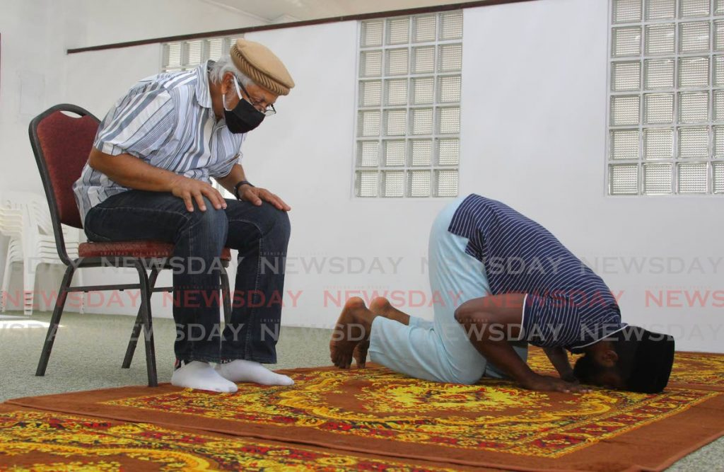 Imam Hassan Hosein and Maulana Noor Janel Auguste were the only two to perform 'salaatul' prayers at the Ahmadiyya Muslim Jamaat of Bail-ul-Azzez mosque in Valencia on April 24 when no more than five people were allowed at religious gatherings. The Prime Minister on Saturday announced all places of worship will reopen on June 12. PHOTO BY ROGER JACOB  -