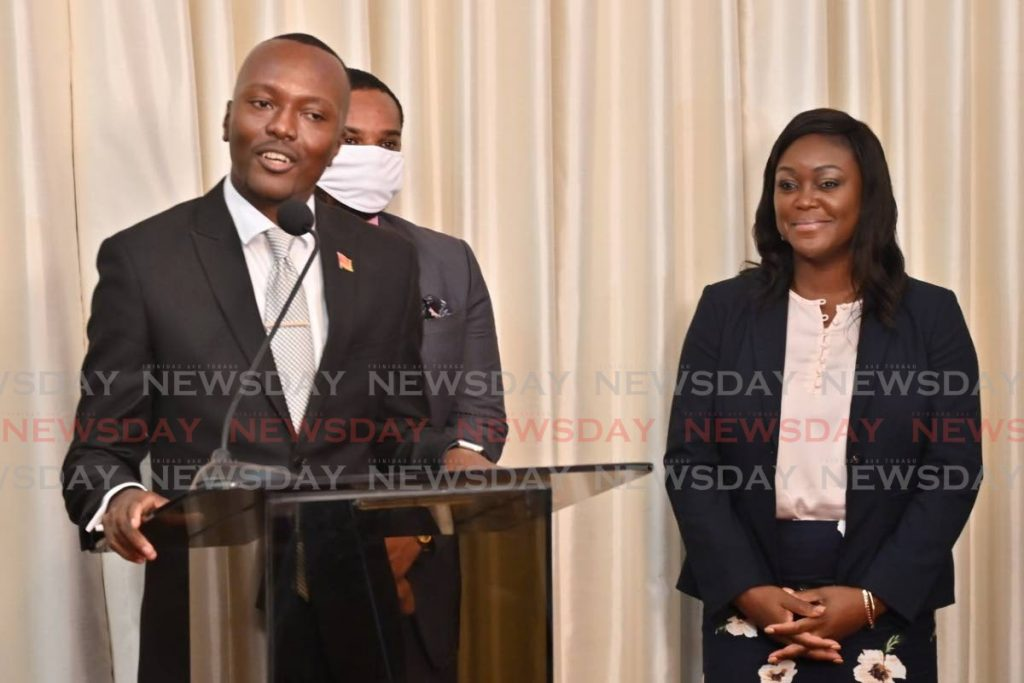 Chief Secretary Ancil Dennis in a speech last month at the Assembly Legislature in Scarborough. At right is Health Secretary Tracy Davidson-Celestine.  -