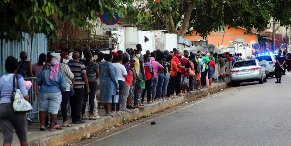 File photo from the morning of May 29, when people lined up on Frederic Street, Port of Spain hoping to collect hampers from the Living Water Community.   - SUREASH CHOLAI