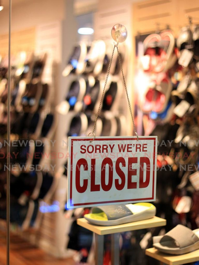 A closed sign on the door of one of the stores in Trincity Mall. As the country emerges from covid19 restrictions, people want to return to work and employers want to go back to pre-lockdown status. But the economic impact of the virus and restriction to curb its spread are making it difficult. - ROGER JACOB