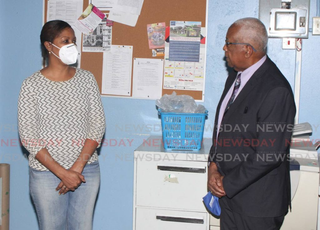 Education Minister Anthony Garcia speaks to Newtown Girls' RC School principal Allison Ramah during a visit to the school in Port of Spain on June 9. PHOTO BY ANGELO MARCELLE -