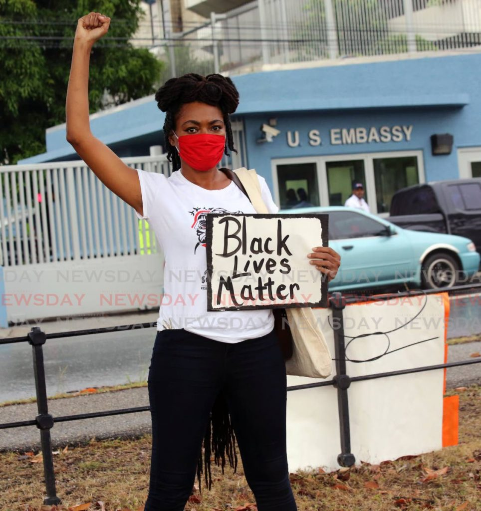 A protester stands up for the Black Lives Movement during a protest at the Queen's Park Savannah, Port of Spain, opposite the US Embassy, on June 8. -