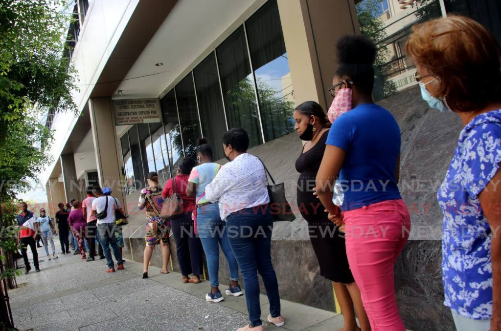 Members of the public line up to see about their ID cards at the Elections and Boundaries Commission's head office, Scott House, Frederick Street, Port of Spain on June 8. The EBC said a new type of ID card will be issued at a date to be determined. - SUREASH CHOLAI