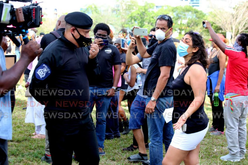 LISTENING EAR: Police Commissioner Gary Griffith chats with one of the women who turned up at the Queen's Park Savannah on Monday in solidarity with the Black Lives Matter movement in the US. - SUREASH CHOLAI