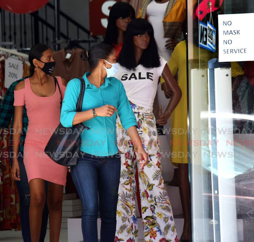 Shoppers out and about in their  facemasks in Port  of Spain on Friday.  PHOTO BY SUREASH CHOLAI - SUREASH CHOLAI