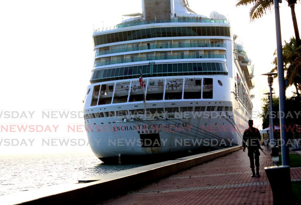 A soldier guards Royal Caribbean's Enchantment of the Seas which docked in Port of Spain with 306 nationals onboard on Friday. They will remain in quarantine for 14 days. PHOTO BY SUREASH CHOLAI -