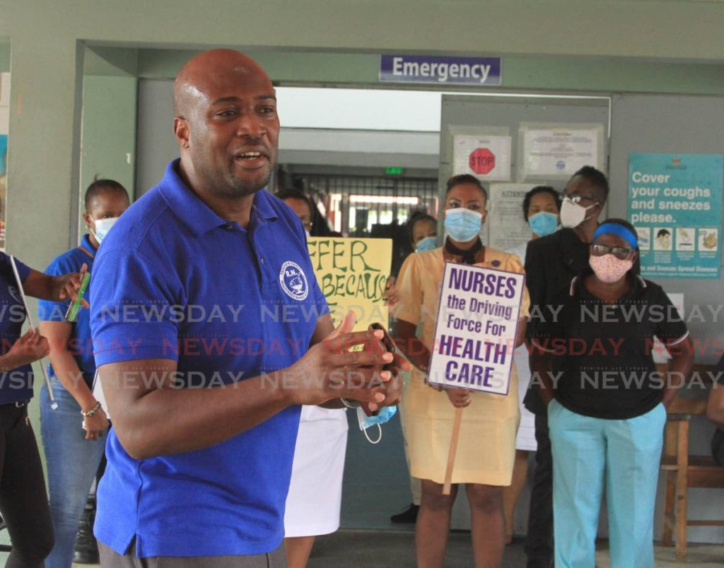 President of the Trinidad and Tobago Registered Nurses' Association Idi Stuart address nurses during a protest at the Arima Health Care Facility on Monday. - Ayanna Kisnale