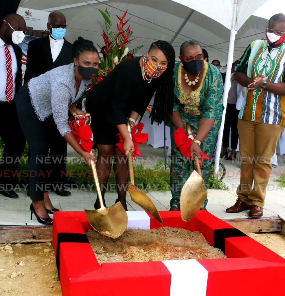 Udecott acting CEO Tamica Charles (L), Minister of Sports and Youth Affairs Shamfa Cudjoe (C) and Arouca/Maloney MP Camille Robinson-Regis turn the sod to the Maloney Community Swimming Pool, at Flamingo Blvd, Maloney, on Tuesday. - SUREASH CHOLAI