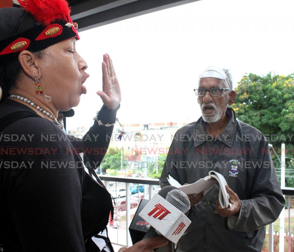 Queen of the Warao Nation, Donna Bermudez-Bovell, gets vocal with a man at City Hall, on Wednesday. The Queen is demanding the removal of the Christopher Columbus statue from Tamarind Square, Port-of-Spain.  - Angelo Marcelle