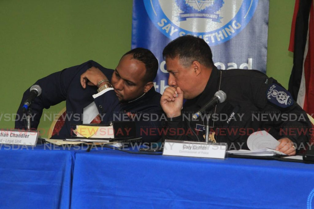 SECRET TALKS: Police Commissioner Gary Griffith, right, speaks with head of the Legal Unit, Christian Chandler, on Thursday at the weekly police press briefing.   - Angelo Marcelle