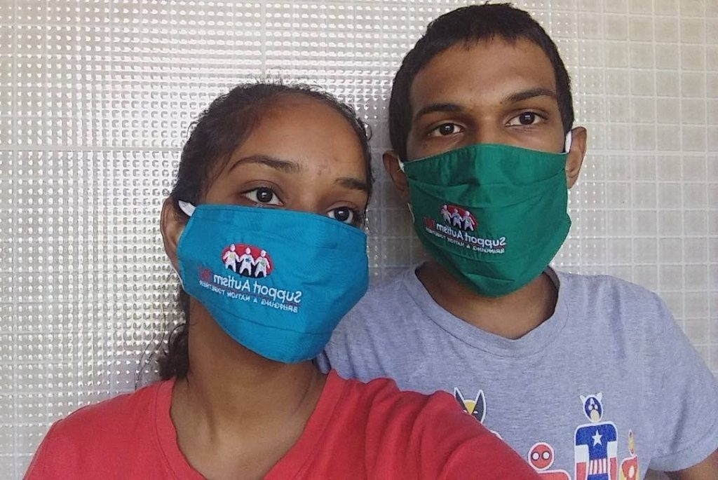 Many children with autism such as Rahal, right, cannot wear face masks for more than a few minutes. -