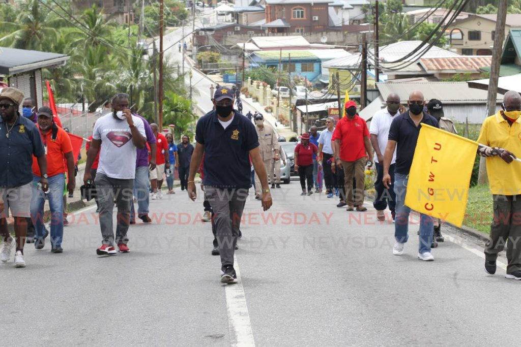 LEADER: OWTU president general Ancel  Roget, centre, leads a significantly smaller  Labour Day march along Fyzabad Main Road  on Friday. PHOTO BY LINCOLN HOLDER -