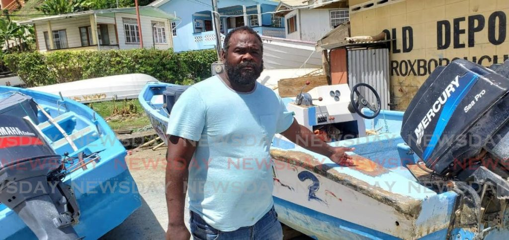Roxborough fisherman Brian Daniel shows two of the boats that were damaged by Tropical Storm Karen on September 22, 2019. -