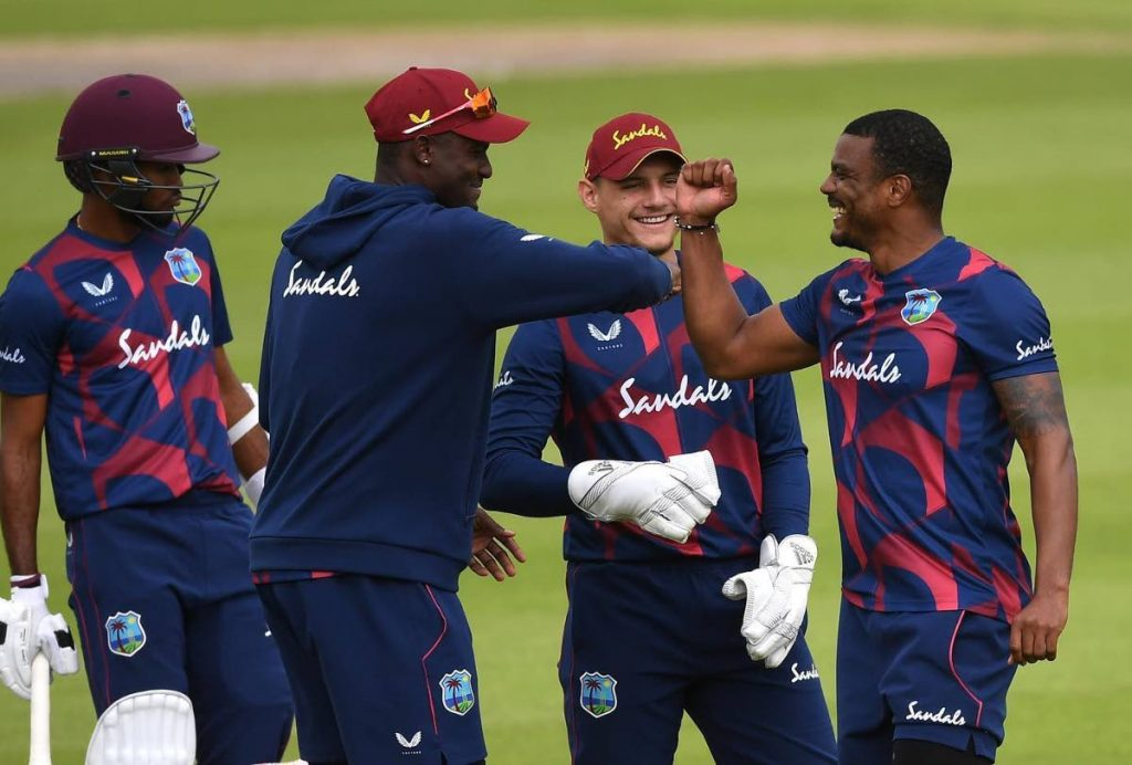 Shannon Gabriel (right) celebrates a dismissal with captain Jason Holder (second from left) and wicketkeeper Joshua Da Silva (second from right) during the first day of the West Indies inter-squad warm-up match between the Jason Holder XI and the Kraigg Brathwaite XI at the Emirates Old Trafford, England on Tuesday. Also in photo is Kraigg Brathwaite. PHOTO COURTESY WINDIES CRICKET FACEBOOK PAGE. -