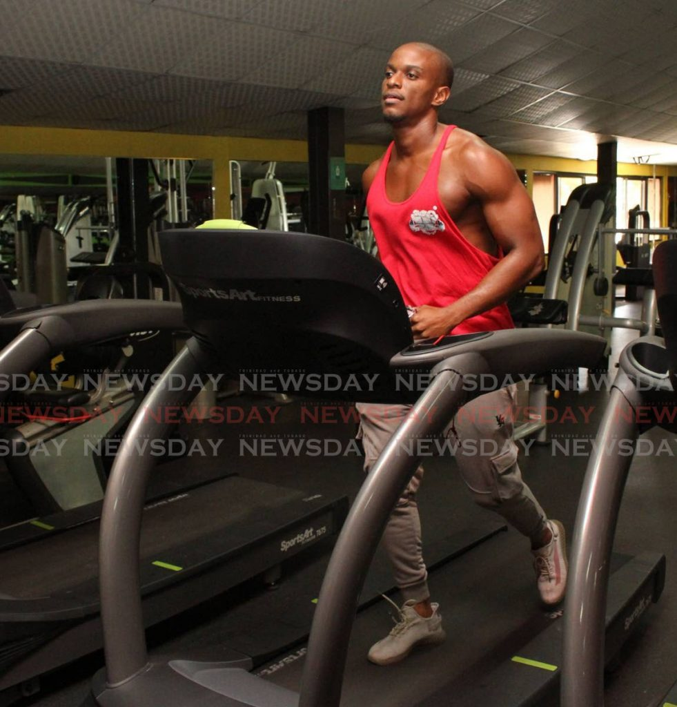Fitness instructor Joel Adams warms down on the treadmill at Life Fitness gym, Arima. - Angelo M. Marcelle