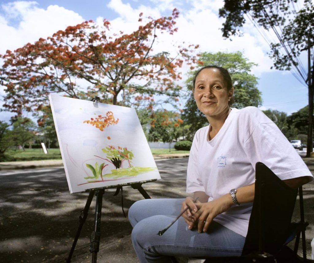 Lisa O'Connor photographed at the south-eastern end of Nelson Mandela Park, then known as King George VI Park working on a painting in 2003. Photograph by Mark Lyndersay. - Mark Lyndersay