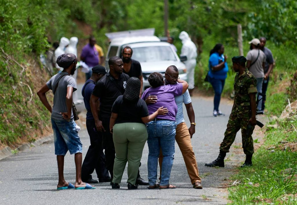 SORROW: Relatives of murder victim Dwight Turpin near the scene where he was shot to death on Wednesday.  - LEEANDRO NORAY