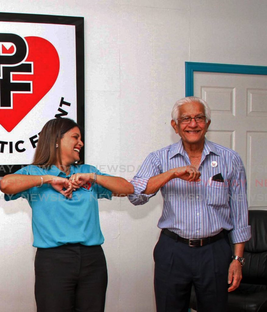 FLASHBACK: Political leader of the Patriotic Front party Mickela Panday, touches elbows with her father and general election campaign manager Basdeo Panday at a press conference in June. On Tuesday, she announced the party would not contest the general election. FILE PHOTO -