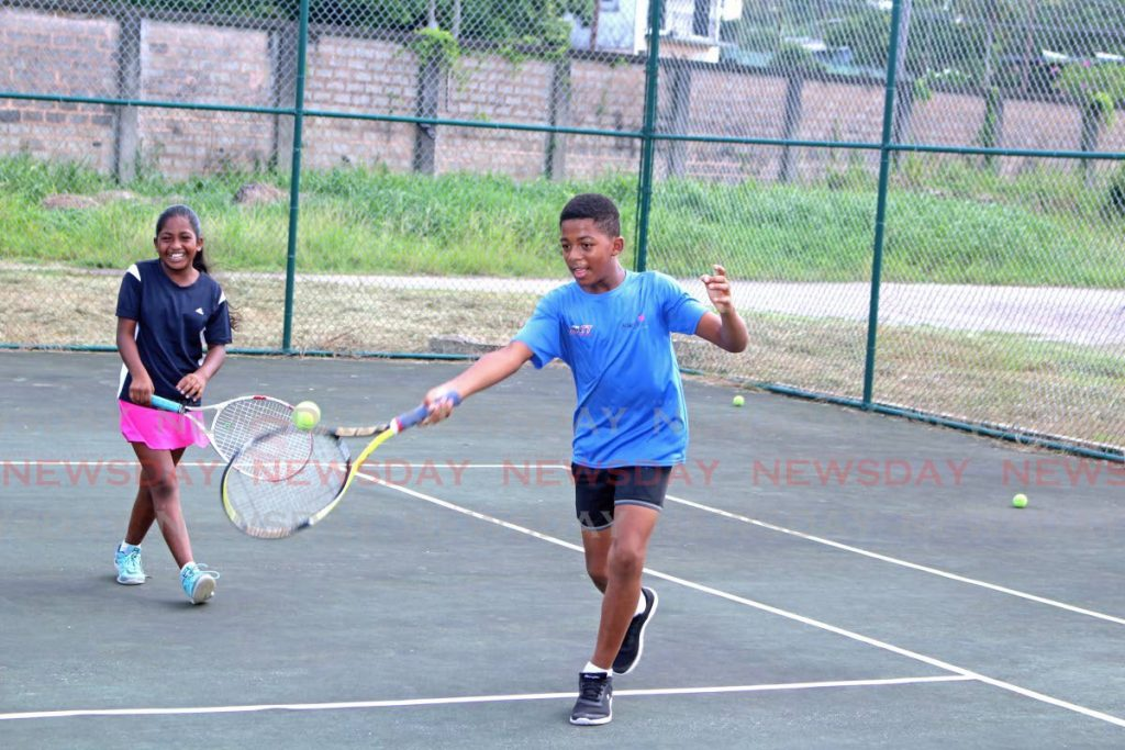 Jayshaun Hamlet and Naomi Mohammed practise together at Harriman Park,  Port Fortin last Thursday.  PHOTOS BY CHEQUANA WHEELER -