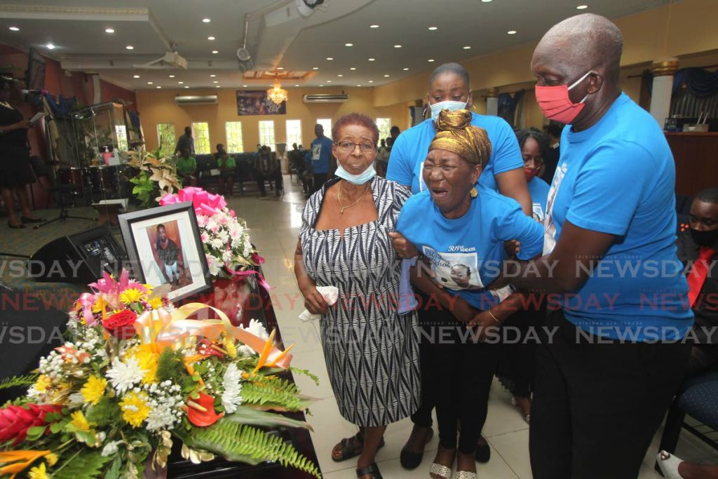 Rosabell Brown Nelson, mother of Marlene Nelson in grief at her daughter's funeral at the Revival Mission church in La Romaine on Friday. - L Holder